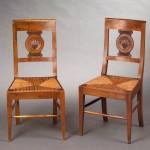 Paire de chaises paillées Consulat, bois naturel, assise paillée, France, début du XIXe siècle.